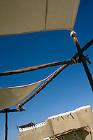 The blazing blue Egyptian sky seen from under a white cotton awning on one of the terraces