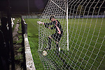 Bacup Borough 4 Holker Old Boys 1, 25/04/2016. Brain Boys West View Stadium, NorthWest Counties League Division One. The visiting keeper retrieves the ball from the net during the second-half at the Brain Boys West View Stadium as Bacup Borough (in black) play Holker Old Boys in a NorthWest Counties League division one fixture. Formed as Bacup in 1879, the club moved into their current home in 1889 and have been known as Bacup Borough since the 1920s, apart from a brief recent spell when they added the name Rossendale to their name. With both teams challenging for play-off places, Bacup Borough won this fixture by 4-1, watched by a crowd of 50. Photo by Colin McPherson.