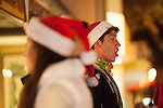 A member of the Mountain View High School madrigals sings a carol during the Holiday Stroll.