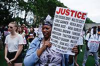 A woman take part during a rally for the first anniversary of the death of Eric Garner in Brooklyn New York 07/18/2015. Kena Betancur/VIEWpress