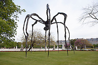 """PARIS, FRANCE -  APRIL 27 :  A low angle view of  """"Maman"""" on April 27 2008, in Paris, France. The 9.1 metre high, steel spider is the largest of a series of spider sculptures by Louise Bourgeois, who was born in Paris in 1911 and now lives and works in New York, USA. """"Maman"""" was created in 1999. It carries a metal mesh sack of white marble eggs beneath her. The spider has travelled to various cities and is seen here in Paris on a spring morning. (Photo by Manuel Cohen)"""