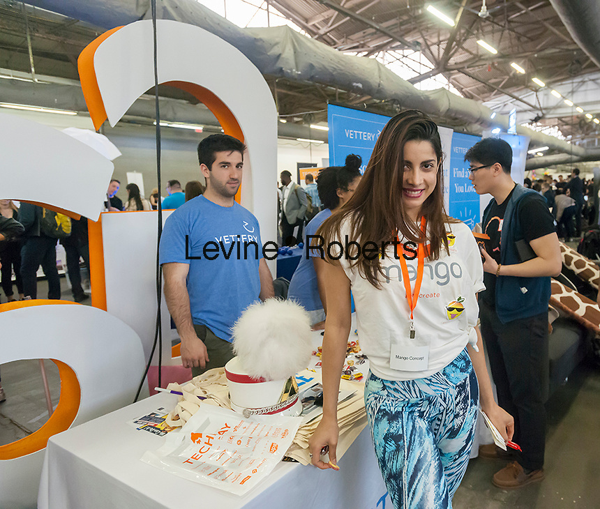 A worker for Mango Concept at the TechDay New York event on Tuesday, April 18, 2017. Thousands attended to seek jobs with the startups and to network with their peers. TechDay bills itself as the U.S.'s largest startup event with over 500 exhibitors. (© Richard B. Levine)