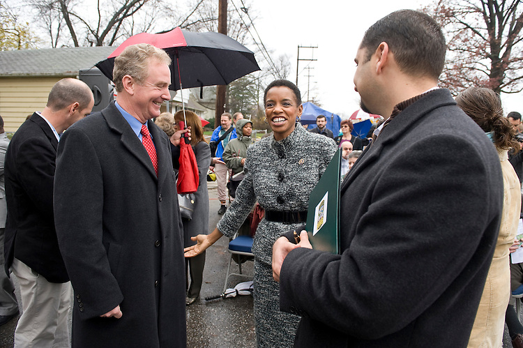 "from left, Rep. Chris Van Hollen, D-Md., Rep. Donna Edwards, D-Md., and Edmonston Mayor Adam Ortiz talk before the start of the groundbreaking ceremony for the Edmonston Green Street project on Decatur Street in Edmonston, Md., on Tuesday, Nov. 24, 2009. The project includes wind-powered LED street lamps, shade trees, rain gardens and lighter colored pavement. Funding from the Recovery Act is being used to make Decatur Street the ""Greenest Street on the East Coast."""