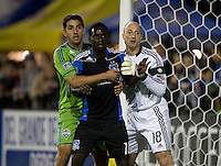 Simon Dawkins of Earthquakes gets sandwiched by Leonardo Gonzalez of Sounders and Sounders goalkeeper Kasey Keller during the game at Buck Shaw Stadium in Santa Clara, California on April 2nd, 2011.   San Jose Earthquakes and Seattle Sounders are tied 1-1 at halftime.