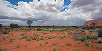 A rain shower passing in the vicinity of Uluru/Ayers Rock on an otherwise sunny afternoon