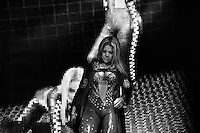 """A female Lucha libre wrestler Tiffany walks out for her fight at Arena Mexico in Mexico City, Mexico, 26 April 2011. Lucha libre, literally """"free fight"""" in Spanish, is a unique Mexican sporting event and cultural phenomenon. Based on aerial acrobatics, rapid holds and the use of mysterious masks, Lucha libre features the wrestlers as fictional characters (Good vs. Evil). Women wrestlers, known as luchadoras, often wear bright shiny leotards, black pantyhose or other provocative costumes. Given the popularity of Lucha libre in Mexico, many wrestlers have reached the cult status, showing up in movies or TV shows. However, almost all female fighters are amateur part-time wrestlers or housewives. Passing through the dirty remote areas in the peripheries, listening to the obscene screams from the mainly male audience, these no-name luchadoras fight straight on the street and charge about 10 US dollars for a show. Still, most of the young luchadoras train hard and wrestle virtually anywhere dreaming to escape from the poverty and to become a star worshipped by the modern Mexican society."""