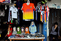 Muslim-run shop in the main bazaar of Ambon City. The 1999-2002 religious war between Maluku's Christian and Muslim populations, mainly centred on Ambon Island, led to over 5000 deaths and to around 500,000 people become displaced. Destroyed homes and offices, churches and mosques are slowly being either torn-down or renovated.  Urban centres, such as Ambon City, continue to be split along largely sectarian lines, and tensions are never far below the surface. Riots between Christian and Muslim youths erupted in September 2011 and, most recently, June 2012, though luckily simmered down just as quickly, partly due to community leaders learning how to defuse tensions from the earlier, more devastating, conflagration. /Felix Features