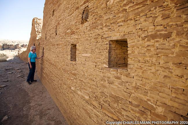 A visitor examines the ruins at Chaco Canyon National Monument