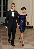 Richard Wolffe and Dr. Paula Cuello arrive for the Official Dinner in honor of Prime Minister David Cameron of Great Britain and his wife, Samantha, at the White House in Washington, D.C. on Tuesday, March 14, 2012..Credit: Ron Sachs / CNP.(RESTRICTION: NO New York or New Jersey Newspapers or newspapers within a 75 mile radius of New York City)