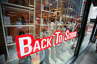 Back to school specials are advertised in the window of the Century 21 department store in Lower Manhattan in New York on Saturday, August 6, 2011. The back to school shopping season is the second busiest time for retailers after Christmas. (© Richard B. Levine)