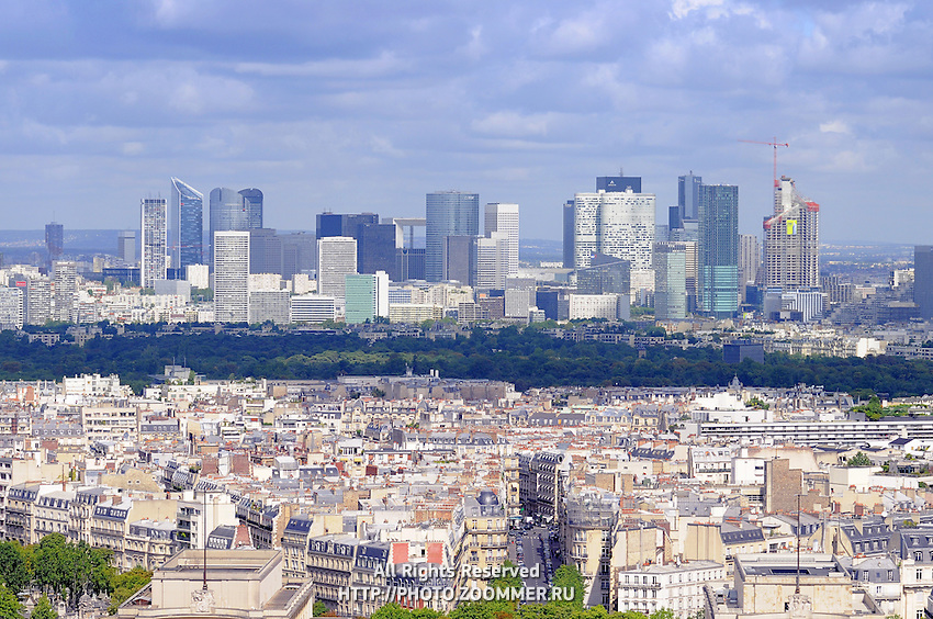 Paris cityscape with Defense district skyscrapers on horizon and old town in the lower part.