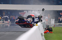 Sept. 16, 2012; Concord, NC, USA: NHRA pro stock driver Shane Gray flips over as he crashes during the O'Reilly Auto Parts Nationals at zMax Dragway. Gray would be uninjured. Mandatory Credit: Mark J. Rebilas-
