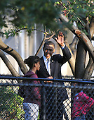Chicago, IL - November 4, 2008 -- United States Senator Barak Obama (Democrat of Illinois) waves to well-wishers as he prepares to vote at Beulah Shoesmith Elementary School in Chicago, Illinois on Tuesday, November 4, 2008.  His daughters Malia, left and Sasha, right, look on..Credit: Ron Sachs / CNP.(Restriction: No New York Metro or other Newspapers within a 75 mile radius of New York City)