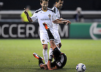 DC United midfielder Andy Najar (14) gets fouled by Los Angeles Galaxy forward Mike Magee (18)   DC United tied  Los Angeles Galaxy 1-1, at RFK Stadium, Saturday April 9, 2011.