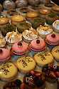 London, UK. 15.11.2014. Cakes and sweet treats for sale on a stall at Borough Market. Photograph © Jane Hobson.
