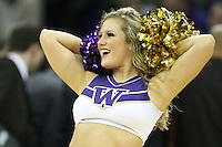February 12, 2014:   UW Cheer member Hannah Tripp entertained fans during the game between Washington's against Stanford.  Washington defeated Stanford 64-60 at Alaska Airlines Arena in Seattle, Washington.