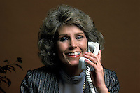 communicate, communication, talk, talking, converse, conversation, Female office worker on telephone with cllient associate