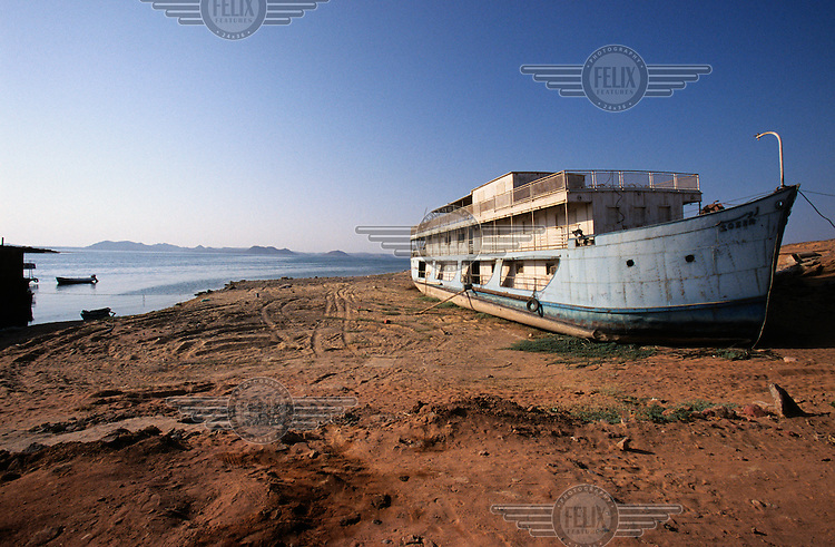 An abandoned Russian cruise boat, which was used to transport engineers working on the translocation of the rock temples at Abu Simbel.  The UNESCO-supervised operation to move the colossal carved rock temples at Abu Simbel  began in 1963, before the spring floodwaters were due to build up behind the Aswan High Dam the following year and flood the ancient archaeological site...