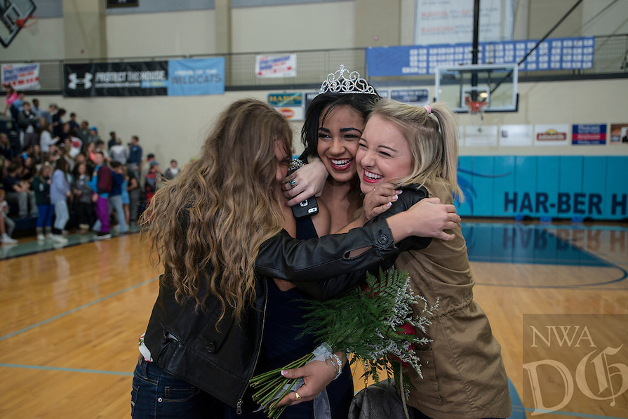 NWA Democrat-Gazette/ANTHONY REYES &bull; @NWATONYR<br /> Breanna Cassinelli gets hugs from her friends Friday, Jan. 30, 2015 after she was announced as the Winter Homecoming Queen between games in Wildcat Arena in Springdale.