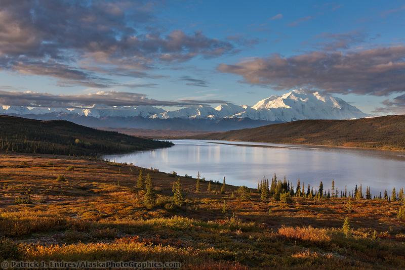 Morning light falls on Denali and the autumn tundra surrounding Wonder Lake, Denali National park, Alaska.