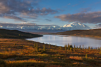 Morning light falls on Mt McKinley and the autumn tundra surrounding Wonder Lake, Denali National park, Alaska.