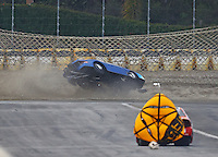 Feb 11, 2017; Pomona, CA, USA; NHRA top sportsman driver Phil Dion flips over in the sand trap in his Dodge Avenger car after his parachutes failed to deploy during eliminations at the Winternationals at Auto Club Raceway at Pomona. Dion walked away from the crash. Mandatory Credit: Mark J. Rebilas-USA TODAY Sports