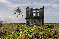Indonesia - Sumatra - Aceh - Padang Seurahet - The skeleton of a villa destroyed by the tsunami stands in a now unihabited area regularly submerged by the high tide.