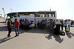 Palestinian pilgrims arrive at the Rafah crossing between Gaza Strip and Egypt after performing the annual Hajj, in Rafah in southern Gaza Strip, September 30, 2015. Around 500 Hajj pilgrims cross Rafah crossing on Wednesday following Egyptian authorities allow Hajj pilgrims to cross into Gaza Strip. Photo by Abed Rahim Khatib