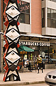 Public art sculpture and Starbucks coffee shop in the Pearl District of Portland, Oregon.