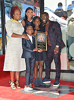 LOS ANGELES, CA. October 10, 2016: Kevin Hart &amp; wife Eniko Parrish &amp; his first wife Torrei Hart (left) &amp; their children Hendrix Hart &amp; Heaven Hart at the Hollywood Walk of Fame Star Ceremony honoring comedian Kevin Hart.<br /> Picture: Paul Smith/Featureflash/SilverHub 0208 004 5359/ 07711 972644 Editors@silverhubmedia.com