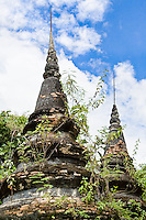 The jungle gradually reclaims this abandoned temple. (Photo by Matt Considine - Images of Asia Collection)