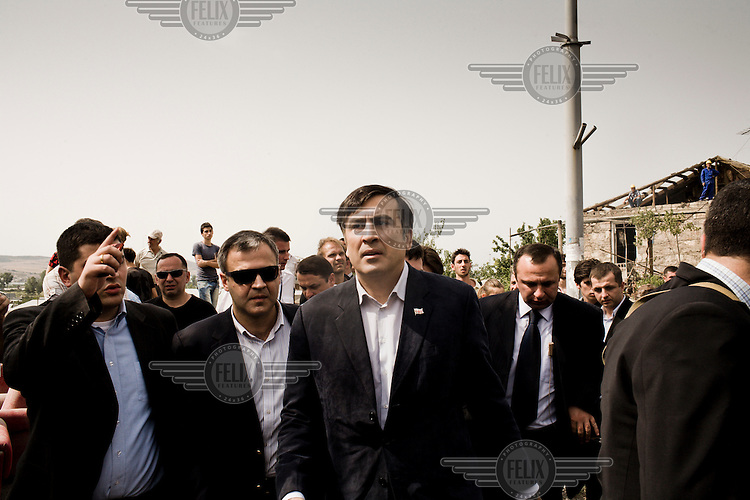 President Sakashvili tours the heavily bomb damaged area of Gori as he sees for himself the damage caused by a Russian aerial bombardment.