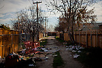 Alleys are often used for illegal dumping in the Parklawn neighborhood in Modesto, Calif., February 22, 2012.