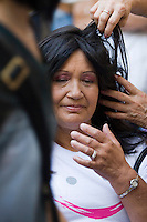 Fanny Gomez tests her new wig during a donation ceremony as a commitment to actively fight against cancer in Medellin, Colombia, May 25, 2012.  Colombia celebrated on 31 January, 7, 14 and 21 February some days of donating hair in Beauty Centres Fundayama ALQVIMIA and foundation (Foundation for support and support people with breast cancer), it received 300 donations of hair with which they made 200 wigs  Photo by Fredy Amariles/View