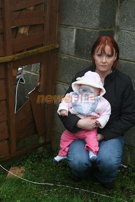 Sandra Cleary and her 5 month old daughter Sophie at the fence where a pit bull broke into their garden....Photo NEWSFILE/Jenny Matthews.(Photo credit should read Jenny Matthews/NEWSFILE)....This Picture has been sent you under the condtions enclosed by:.Newsfile Ltd..The Studio,.Millmount Abbey,.Drogheda,.Co Meath..Ireland..Tel: +353(0)41-9871240.Fax: +353(0)41-9871260.GSM: +353(0)86-2500958.email: pictures@newsfile.ie.www.newsfile.ie.FTP: 193.120.102.198..