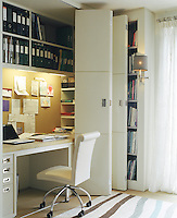 In this home office the desk can be quickly tidied away behind a clever arrangement of sliding doors