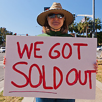 """Laurel holds a """"We got sold out"""" sign at the Occupy Orange County, Irvine camp on November 5."""