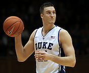 "Senior Miles Plumlee eyes the net during the dunk contest. Duke men's basketball had an opening scrimmage game as a part of the ""Countdown to Craziness"" event at Cameron Indoor Stadium Friday Oct. 14, 2011.  Photo by Al Drago..."