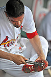 8 March 2012: St. Louis Cardinals' pitcher Jaime Garcia scrapes first from his cleats during a Spring Training game against the Boston Red Sox at Roger Dean Stadium in Jupiter, Florida. The Cardinals defeated the Red Sox 9-3 in Grapefruit League action. Mandatory Credit: Ed Wolfstein Photo