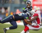 Seattle Seahawks wide receiver Jermaine Kearse (15) blocks Arizona Cardinals Antonio Cromartie (31)as quarterback Russell Wilson (3) scrambles at CenturyLink Field in Seattle, Washington on November 23, 2014. Wilson rushed for 73 yards, completed 17 of 22 passes for 211 yards and one touchdown in the Seahawks 19-3 win over the Cardinals.    ©2014. Jim Bryant Photo. All Rights Reserved.