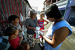 """THIS PHOTO IS AVAILABLE AS A PRINT OR FOR PERSONAL USE. CLICK ON """"ADD TO CART"""" TO SEE PRICING OPTIONS.   Ljatife Sikovska (right) is director of Ambrela, a grassroots Roma women's organization in Suto Orizari, the Macedonian municipality that is Europe's largest Roma settlement. Here she talks with a woman on a street in Suto Orizari about the woman's lack of sufficient legal documents, a common headache for Roma in Macedonia."""