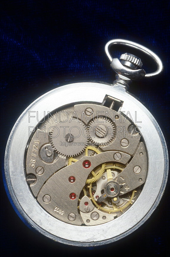 MECHANICAL WATCH MECHANISM<br /> Showing Winding Mechanism And Gears<br /> Gears can transfer motion from one place to another. They are used to reverse the direction of rotation, increase or decrease the speed of rotation, move rotational motion to a different axis, or keep the rotation of two axes synchronized.