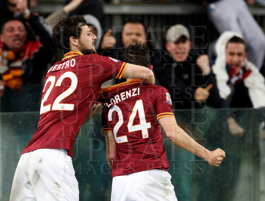 Calcio, Serie A: Roma vs Torino. Roma, stadio Olimpico, 25 marzo 2014.<br /> AS Roma midfielder Alessandro Florenzi celebrates with teammate Mattia Destro, left, after scoring the winning goal in the last minutes of the Italian Serie A football match between AS Roma and Torino at Rome's Olympic stadium, 25 March 2014. AS Roma won 2-1.<br /> UPDATE IMAGES PRESS/Riccardo De Luca