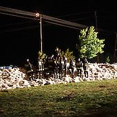 DOBRZYKOW, POLAND, MAY 23, 2010:.Rescue workers observing rising water behind the sand bags wall, late at night..The latest chapter of disastrous floods in Poland has been opened today, May 23, 2010, after Vistula river broke its banks and flooded over 25 villages causing evacualtion of most inhabitants..Photo by Piotr Malecki / Napo Images..DOBRZYKOW, POLSKA, 23/05/2010:.Strazacy pozna noca obserwuja podnoszaca sie wode po drugiej stronie sciany z workow z piaskiem. Najnowszy akt straszliwych tegorocznych powodzi zostal rozpoczety dzis gdy Wisla przerwala waly na wysokosci wsi Swiniary kolo Plocka..Fot: Piotr Malecki / Napo Images ..