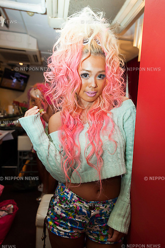 Pomitan (24), store manager, poses for a picture at the Ganguro Cafe &amp; Bar in the Shibuya shopping area on September 4, 2015. <br /> <br /> Ganguro is an alternative Japanese fashion trend which started in the mid-1990s where young women, rebelling against the traditional idea of Japanese beauty, wore colorful make-up and clothes and had dark-skin.<br /> <br /> 10 Ganguro fashion girls work in the new bar, which offers original Ganguro Balls (fried takoyaki style sausage balls in black squid ink batter) on its menu. Ganguro Caf&eacute; &amp; Bar also offers special services such as Ganguro make-up and the chance to take purikura (photo booth pictures) with staff and to look like a Ganguro girl walking around the Shibuya streets.<br /> <br /> The bar is popular with both Japanese and foreigners and has menus translated in English. (Photo by Rodrigo Reyes Marin/AFLO)