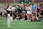 Martha Compton, director of Community Standards and Student Responsibility for Ohio University, directs students on the field at Peden Stadium before the Class of 2020 photo on Saturday, August 20, 2016. © Ohio University / Photo by Kaitlin Owens