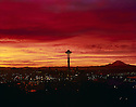 26585-02...WASHINGTON - 1962 photograph of a sunrise over Seattle and the Space Needle with Mount Rainier in the distance.