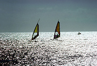 Image is of wind surfing in Aruba. Approximate date is 1991 and scanned from Kodachrome 64.  (Photo by Tom Theobald)