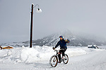 Benn Dunn takes a short bike ride to the local shuttle for quick trip to the ski mountain. Michael Brands for The New York Times.