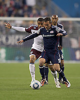 Colorado Rapids forward Caleb Folan (21) and New England Revolution defender A.J. Soares (5) battle for the ball. In a Major League Soccer (MLS) match, the New England Revolution tied the Colorado Rapids, 0-0, at Gillette Stadium on May 7, 2011.